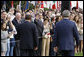 Crowds on the South Lawn of the White House cheer President George W. Bush and Italian Prime Minister Silvio Berlusconi Monday, Oct. 13, 2008, during the official welcoming ceremony for the prime minister. White House photo by Eric Draper