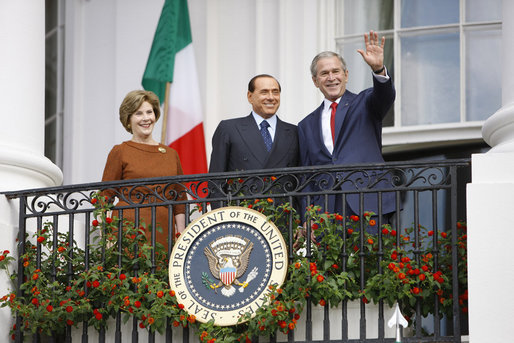President George W. Bush andMrs. Laura Bush stand with Italian Prime Minister Silvio Berlusconi on the balcony of the South Portico of the White House Monday, Oct. 13, 2008, during Prime Minister Berlusconi's official welcome to the White House. White House photo by Eric Draper