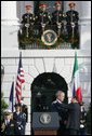 President George W. Bush is embrace by Prime Minister Silvio Berlusconi folllowing President Bush's remarks Monday, Oct. 13, 2008 , welcoming Prime Minister Berlusconi to the White House. White House photo by Chris Greenberg