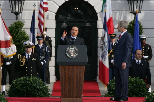 President George W. Bush listens as Prime Minister Silvio Berlusconi addresses his remarks Monday, Oct. 13, 2008, during ceremonies on the South Lawn to welcome Prime Minister Berlusconi to the White House. White House photo by Chris Greenberg