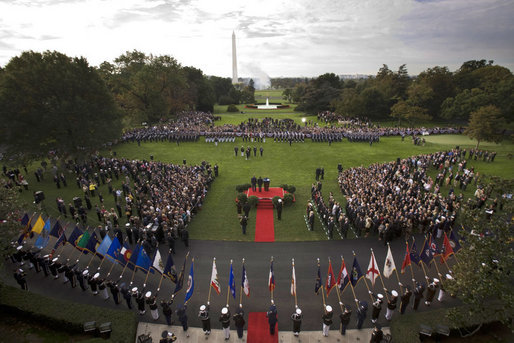 President George W. Bush and Prime Minister Silvio Berlusconi of Italy, seen from the Truman Balcony of the White House, stand together during the playing of the National Anthems at the South Lawn Arrival Ceremony of Prime Minister Silvio Berlusconi of Italy Monday, Oct. 13, 2008, at the White House. White House photo by Grant Miller