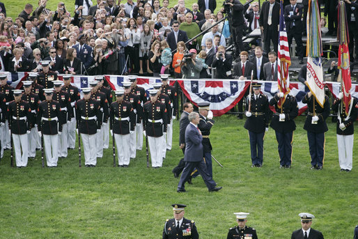 President George W. Bush and Italian Prime Minister Silvio Berlusconi review the troops during welcoming festivities Monday, Oct. 13, 2008, on the South Lawn of the White House. White House photo by Grant Miller