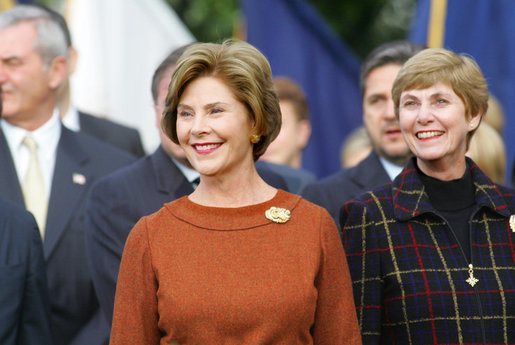 Mrs. Laura Bush and Mrs. Deborah Mullen, wife of the Chairman of the Joint Chiefs of Staff, Admiral Mike Mullen, watch the White House South Lawn ceremonies Oct. 13, 2008, for the State Arrival of Italian Prime Minister Silvio Berlusconi. White House photo by Joyce N. Boghosian