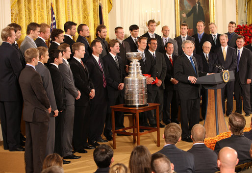 President George W. Bush welcomes the Detroit Red Wings NHL Hockey team, winners of the 2008 Stanley Cup, Tuesday, Oct. 14, 2008, to the East Room at the White House. White House photo by Chris Greenberg