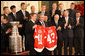 President George W. Bush stands with Detroit Red Wings captain Nicklas Lidstrom as they hold up jerseys Tuesday, Oct. 14, 2008 in the East Room at the White House, representing President Bush's father 41 and the President 43, during the ceremony to honor the Red Wings 2008 Stanley Cup championship. White House photo by Chris Greenberg