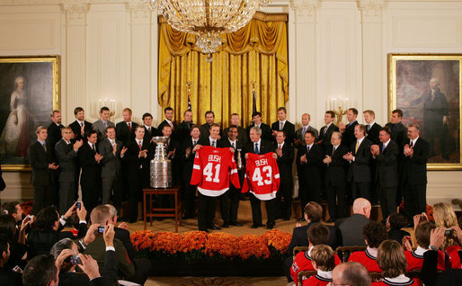 President George W. Bush stands with Detroit Red Wings captain Nicklas Lidstrom as they hold up jerseys Tuesday, Oct. 14, 2008 in the East Room at the White House, representing President Bush's father 41 and the President 43, during the ceremony to honor the Red Wings 2008 Stanley Cup championship. White House photo by Joyce N. Boghosian