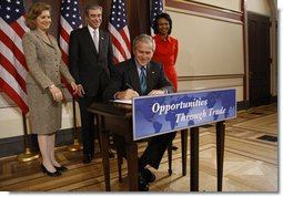 President George W. Bush signs H.R. 7222, the Andean Trade Preference Act Extension Thursday, Oct. 16, 2008, in the Eisenhower Executive Office Building. The bill will extend the Generalized Systems of Preferences (GSP), designed to help developing countries expand their market presence and strengthen their economies, and the Andean Trade Pact, which waives duties on imports from Bolivia, Colombia, Ecuador, and Peru in accordance with a 1991 law. Looking on are Ambassador Susan Schwab, the U.S. Trade Representative, U.S. Secretary of Commerce Carlos Gutierrez and U.S. Secretary of State Condoleezza Rice. White House photo by Eric Draper