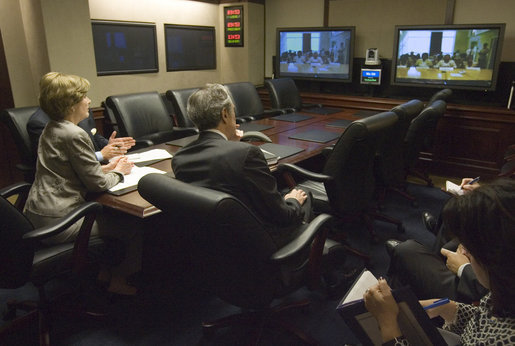 Joined by U.S. Secretary of Commerce Carlos Gutierrez, right, Mrs. Laura Bush talks with the Ladies in White via a video teleconference Thursday, Oct. 16, 2008, in the Situation Room of the White House. The Ladies in White is an organization that includes spouses and other relatives of jailed Cuban dissidents. The organization was formed in 2003 to protest the arrest of 75 dissidents by the Cuban regime. Members of the organization have been consistently detained, threatened, and at times beaten by police during their peaceful protests. White House photo by Joyce N. Boghosian