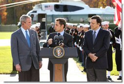 President George W. Bush listens as French President Nicolas Sarkozy, center, adresses the media during a meeting at Camp David to discuss the economic crisis and the need for coordinated global response, Saturday, October 18, 2008. The two presidents are joined by Jose Manuel Barroso, President of the European Commission, at right.  White House photo by Chris Greenberg