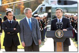 President George W. Bush and French President Nicolas Sarkozy, right, listen as Jose Manuel Barroso, President of the European Commission adresses the media during a meeting at Camp David to discuss the economic crisis and the need for coordinated global response, Saturday, October 18, 2008.  White House photo by Chris Greenberg