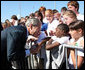 President George W. Bush shakes hands with a young boy as he arrives at Alexandria International Airport - Air National Guard Base Monday, Oct. 20, 2008, in Alexandria, Louisiana. White House photo by Chris Greenberg