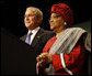 President George W. Bush stands with Liberian President Ellen Johnson Sirleaf before delivering his remarks at the White House Summit on International Development Tuesday, Oct. 21, 2008, in Washington, D.C. President Bush discussed in his remarks core transformational goals of country ownership, good governance, results-based programs and accountability, and the importance of economic growth. White House photo by Eric Draper