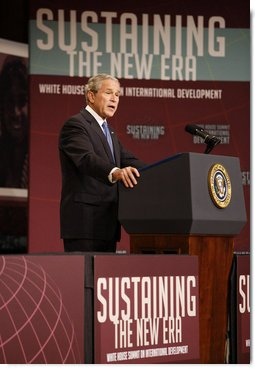 "President George W. Bush delivers remarks at the White House Summit on International Development Tuesday, Oct. 21, 2008, in Washington, D.C. President Bush said during his remarks, ""History shows what happens when America combines our great compassion with our steadfast determination.We are a compassionate people and we are a determined people."" White House photo by Eric Draper"