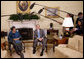 "President George W. Bush and Liberia President Ellen Johnson Sirleaf talk with reporters following their meeting Wednesday, Oct. 22, 2008, in the Oval Office at the White House. President Bush said during his remarks, ""Liberia needs the help of the United States and other nations to help make sure children are educated, to make sure babies are not dying because of malaria, to make sure there's an infrastructure so that small businesses can flourish, to make sure port is open for business. We have been helpful and we want to be helpful in the future."" White House photo by Eric Draper"
