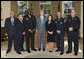 President George W. Bush poses for a photo with the recipients of the Public Safety Officer Medal of Valor Wednesday, Oct. 22, 2008, in the Oval Office at the White House. The Medal of Valor is awarded to public safety officers for extraordinary valor above and beyond the call of duty. White House photo by Chris Greenberg