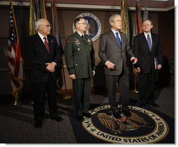 President George W. Bush delivers a statement to the press at the end of his visit Friday, Oct. 24, 2008, to the National Security Agency at Fort Meade, Md. With him are Vice President Dick Cheney, Lt. Gen. Keith B. Alexander, Director of the NSA, and Director of National Intelligence Mike McConnell. White House photo by Eric Draper