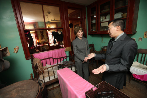 Mrs. Laura Bush visits the Lower East Side Tenement Museum in New York City, Friday, Oct 24, 2008. The tour is led by Mr. David Eng, the museum's Vice President of Public Affairs. The visit was to highlight the importance of historical preservation and celebrate the role immigration has played in America. White House photo by Chris Greenberg