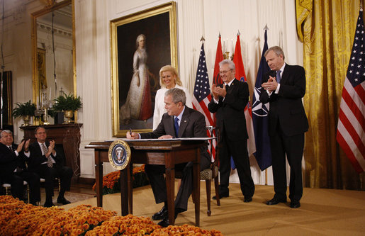 President George W. Bush is joined on stage by Croatian Ambassador to the U.S. Kolinda Grabar-Kitarovic, left, Albanian Ambassador to the U.S. Aleksander Saliabanda and NATO Secretary General Jaap De Hoop Scheffer, right, as he signs the NATO accession protocols Friday, Oct. 24, 2008 in the East Room of the White House, in support of the nations of Albania and Croatia to join the NATO alliance. When all 26 NATO allies have ratified the accession protocols Albania and Croatia will be eligible to join NATO. White House photo by Eric Draper