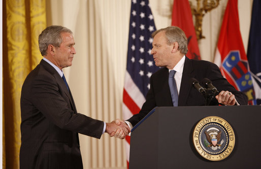 President George W. Bush shakes hands with NATO Secretary General Jaap De Hoop Scheffer Friday, Oct. 24, 2008 in the East Room of the White House, following an address honoring President Bush's support of the NATO accession protocols in support of the nations of Albania and Croatia to join the NATO alliance. White House photo by Eric Draper