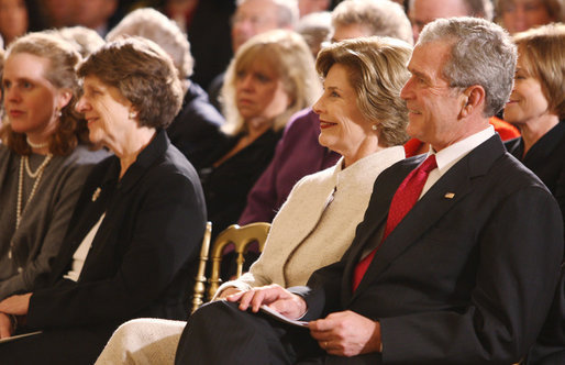 President George W. Bush and Mrs. Laura Bush listen Monday evening, Oct. 27, 2008 in the East Wing of the White House, to the performance of Theodore Roosevelt impersonator Joe Wiegand, during a celebration of the 150th birthday of Theodore Roosevelt. White House photo by Chris Greenberg