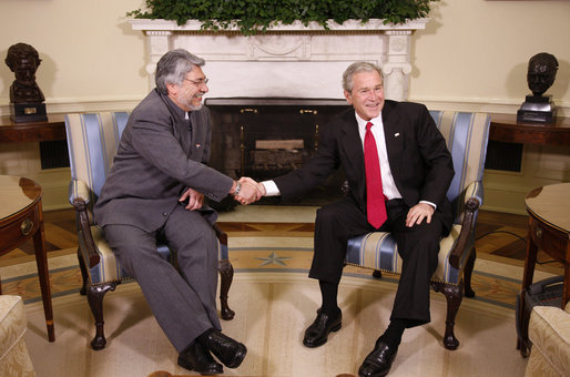 President George W. Bush and Paraguay's President Fernando Lugo shake hands Monday, Oct. 27, 2008, during their meeting with reporters in the Oval Office. White House photo by Eric Draper