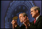 President George W. Bush and FBI Director Robert Mueller applaud the class speaker Thursday, Oct. 30, 2008, at the graduation ceremony for FBI special agents in Quantico, Va. President Bush addressed the graduates and thanked them for stepping forward to serve their country. White House photo by Joyce N. Boghosian