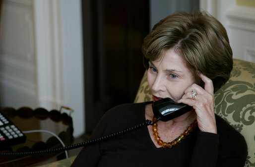 Mrs. Laura Bush speaks on the phone with Michelle Obama Wednesday, Nov. 5, 2008 in the family residence at the White House. Mrs. Bush assured Mrs. Obama that they will enjoy living at the White House, and that it is a wonderful place to raise a family. Also Mrs. Bush extended an invitation to the Obama family to visit the White House. White House photo by Joyce N. Boghosian