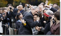 "President George W. Bush embraces an employee of the Executive Office of the President Thursday, Nov. 6, 2008, after delivering remarks to his staff on the upcoming transition. Said the President, "".Over the next 75 days, all of us must ensure that the next President and his team can hit the ground running.'  White House photo by Eric Draper"