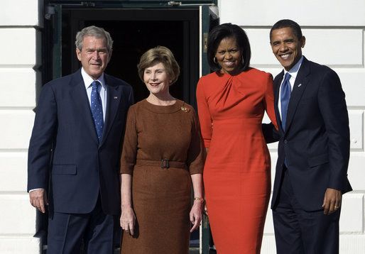 President George W. Bush and Mrs. Laura Bush and President-elect Barack Obama and Mrs. Michelle Obama pause for photographs Monday, Nov. 10, 2008, after the Obama's arrival at the South Portico of the White House. White House photo by Chris Greenberg