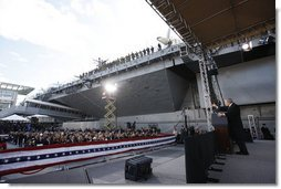 President George W. Bush gestures as he addresses his remarks in honor of Veteran's Day Tuesday, Nov. 11, 2008, at the rededication ceremony of the Intrepid Sea, Air and Space Museum in New York.  White House photo by Eric Draper