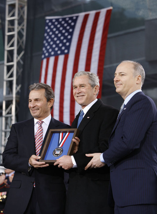 President George W. Bush is presented with the 2008 Intrepid Freedom Award by Rich Santulli, left, and Charles de Gunzberg, co-chairmen of the Intrepid Sea, Air and Space Museum, Tuesday, Nov. 11, 2008, during the rededication of the museum on Veteran's Day in New York. The award recognizes world leaders who embody the ideals of world freedom and democracy. White House photo by Eric Draper