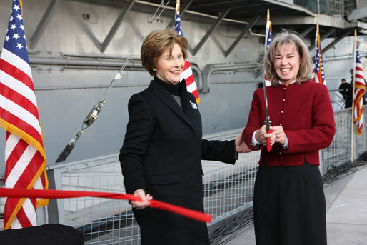 Mrs. Laura Bush and Sally Hoover Casale, daughter of the late U.S. Navy aviator Captain William 'Bill' H. Hoover, complete the ribbon cutting Tuesday, Nov. 11, 2008, to release a bottle for the re-christening of the USS Intrepid, during the rededication ceremony for the Intrepid Sea, Air and Space Museum in New York. White House photo by Chris Greenberg