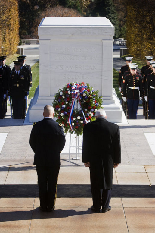 Vice President Dick Cheney stands in silence after placing a wreath at the Tomb of the Unknowns Tuesday, Nov. 11, 2008 during the 55th Annual National Veterans Day Observance at Arlington National Cemetery in Arlington, Va. Standing with the Vice President is Major General Richard J. Rowe Jr., commander of the Military District of Washington. White House photo by David Bohrer