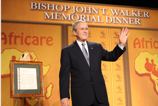 President George W. Bush waves as he acknowledges applause following his remarks Wednesday evening, Nov. 12, 2008, at the 2008 Bishop John T. Walker Memorial Dinner in Washington, D.C., where President Bush was honored with the Bishop John T. Walker Distinguished Humanitarian Service Award from Africare. White House photo by Chris Greenberg