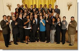 President George W. Bush poses with members of the Arizona State University Men's and Women's Track Team Wednesday, Nov. 12, 2008, during a photo opportunity with 2008 NCAA Sports Champions at the White House.  White House photo by Eric Draper