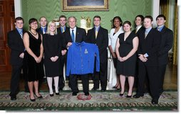 President George W. Bush poses with members of the University of Alaska Fairbanks Men's and Women's Rifle Team Wednesday, Nov. 12, 2008, during a photo opportunity with 2008 NCAA Sports Champions at the White House White House photo by Chris Greenberg