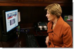 Mrs. Laura Bush, as part of her briefing Thursday, Nov. 13, 2008 on the acid attack against young women on their way to school Wednesday in Kandahar, Afghanistan, reviews press footage about the incident in the East Wing at the White House.  White House photo by Joyce N. Boghosian