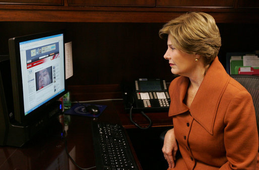 Mrs. Laura Bush, as part of her briefing Friday, Nov. 14, 2008 on the acid attack against young women on their way to school Wednesday in Kandahar, Afghanistan, reviews press footage about the incident in the East Wing at the White House. White House photo by Joyce N. Boghosian