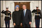 President George W. Bush welcomes Prime Minister Manmohan Singh of India to the White House Friday, Nov. 14, 2008, for the dinner marking the opening of the Summit on Financial Markets and World Economy. White House photo by Chris Greenberg