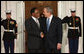 President George W. Bush welcomes President Kgalema Motlanthe of South Africa to the White House Friday, Nov. 14, 2008, for the dinner marking the opening of the Summit on Financial Markets and World Economy. White House photo by Chris Greenberg
