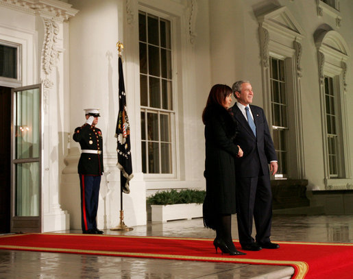 President George W. Bush greets President Cristina Fernandez de Kirchner of Argentina on the North Portico of the White House Friday, Nov. 14, 2008, before a dinner to open the Summit on Financial Markets and World Economy. White House photo by Joyce N. Boghosian