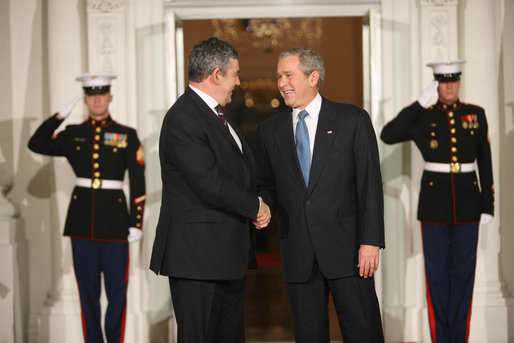 President George W. Bush shakes hands with Prime Minister Gordon Brown, of the United Kingdom, as he's welcomed to the White House Friday, Nov. 14, 2008, for a dinner to open the Summit on Financial Markets and World Economy. White House photo by Chris Greenberg