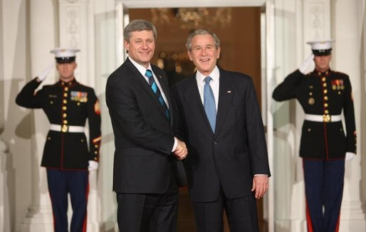 President George W. Bush shakes hands with Canada's Prime Minister Stephen Harper as he's welcomed to the White House Friday, Nov. 14, 2008, for a dinner to open the Summit on Financial Markets and World Economy. White House photo by Chris Greenberg