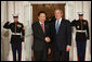President George W. Bush greets Republic of Korean President Lee Myung-bak Friday, Nov. 14, 2008, upon his arrival for dinner with Summit on Financial Markets and World Economy Leaders at the White House. White House photo by Chris Greenberg