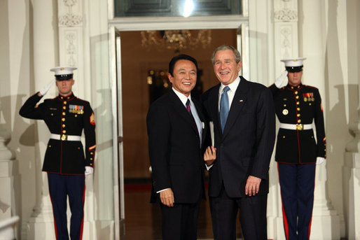 President George W. Bush greets Prime Minister of Japan Taro Aso Friday, Nov. 14, 2008, upon his arrival for dinner with Summit on Financial Markets and the World Economy Leaders at the White House. White House photo by Chris Greenberg