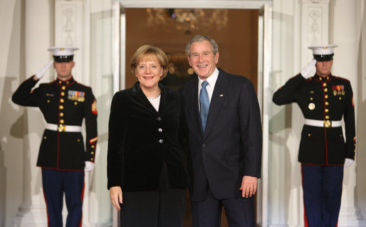 President George W. Bush greets German Chancellor Angela Merkel Friday, Nov. 14, 2008, upon her arrival for dinner with Summit on Financial Markets and World Economy Leaders at the White House. White House photo by Chris Greenberg