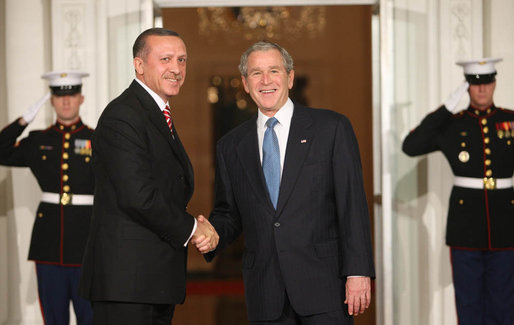 President George W. Bush welcomes Prime Minister Recep Tayyip Erdogan of Turkey, to the White House Friday, Nov. 14, 2008, for dinner marking the opening of the Summit on Financial Markets and World Economy White House photo by Chris Greenberg