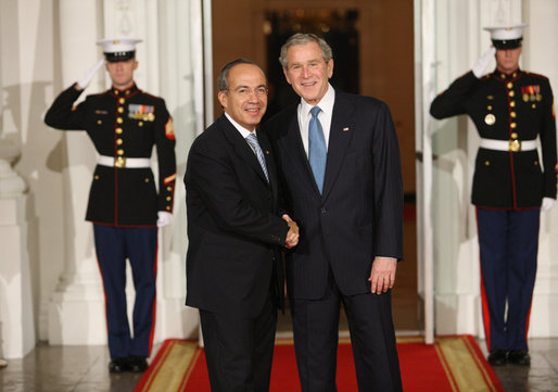 President George W. Bush greets Mexico's President Felipe Calderon Friday, Nov. 14, 2008, upon his arrival for dinner with Summit on Financial Markets and World Economy Leaders at the White House. White House photo by Chris Greenberg