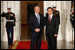 President George W. Bush welcomes President Hu Jintao of the People's Republic of China to the White House Friday, Nov. 14, 2008, for a dinner with Summit on Financial Markets and World Economy Leaders. White House photo by Chris Greenberg