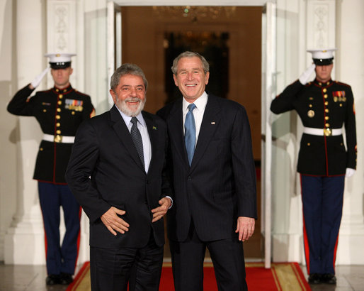 President George W. Bush stands with President Luiz Inacio Lula da Silva of Brazil upon the South American leader's arrival to the White House Friday, Nov. 14, 2008, for a dinner to open the Summit on Financial Markets and World Economy. White House photo by Chris Greenberg